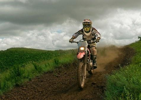 man on trail bike at speed